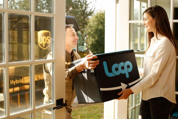 UPS Driver delivers reusable packaging to woman at home